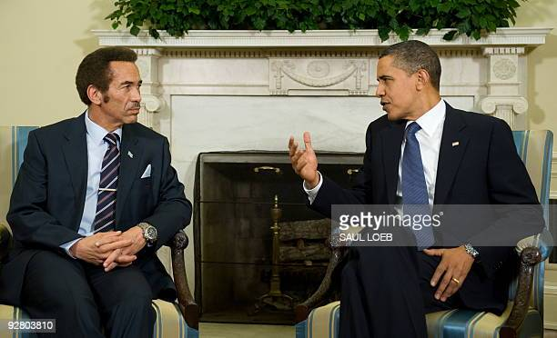 US President Barack Obama talks with Botswana's President Ian Khama during meetings in the Oval Office at the White House in Washington DC November 5...