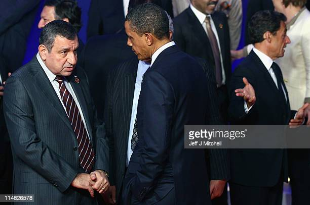 S President Barack Obama talks with Egyptian Prime Minister Essam Sharaf during the family photo at the G8 Summitt on May 27 2011 in Deauville France...