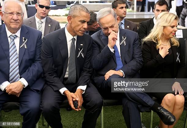 US President Barack Obama talks with Israeli Prime Minister Benjamin Netanyahu as they sit with Israeli President Reuven Rivlin and Sara Netanyahu...