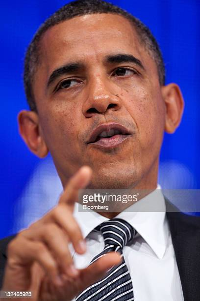 President Barack Obama talks with James McNerney, chief executive officer of Boeing Co., during the Asia-Pacific Economic Cooperation CEO Summit in...