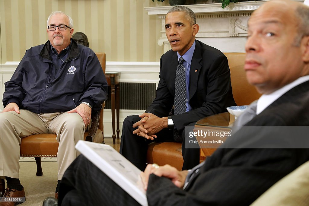 U.S. President Barack Obama (C) talks with reporters after meeting with Federal Emergency Managment Agency Administrator Craig Fugate (L), Homeland Security Secretary Jeh Johnson and others to discuss Hurricane Matthew in the Oval Office at the White House October 7, 2016 in Washington, DC. The hurricane is now a category 3 and is headed for Florida after wreaking havoc in Haiti, Cuba and the Bahamas.