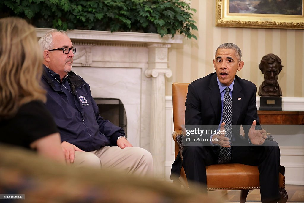 U.S. President Barack Obama (R) talks with reporters after meeting with Federal Emergency Managment Agency Administrator Craig Fugate and other homeland security officials to discuss Hurricane Matthew in the Oval Office at the White House October 7, 2016 in Washington, DC. The hurricane is now a category 3 and is headed for Florida after wreaking havoc in Haiti, Cuba and the Bahamas.