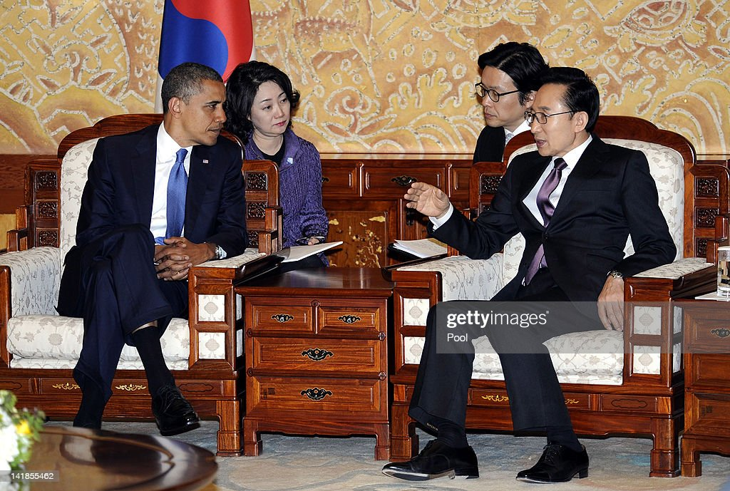U.S. President Barack Obama (L) talks with South Korean President Lee Myung-Bak during a meeting at the presidential house on March 25, 2012 in Seoul, South Korea. World leaders are gathering in Seoul to discuss the threat of nuclear terrorism, the recurrence nuclear power plant meltdown and to minimize nuclear material across the world.