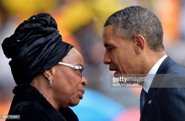 US President Barack Obama talks with the widow of South African President Nelson Mandela Graca Machel during the memorial service for late South...