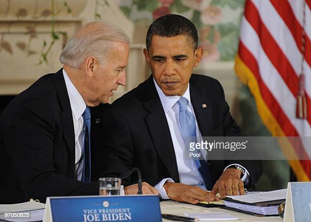 S President Barack Obama talks with US Vice President Joseph Biden after delivering opening remarks during a bipartisan meeting to discuss health...