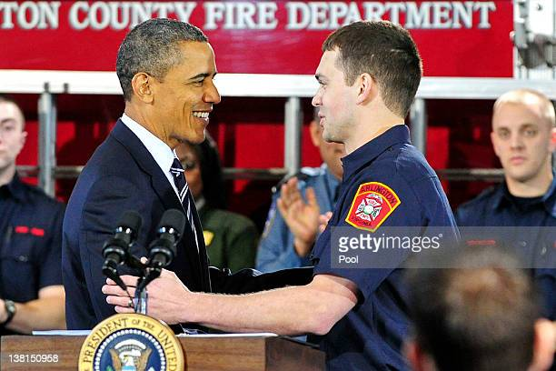 US President Barack Obama thanks Lt Jacob Johnson an Arlington County firefighter and US Marine Corps veteran who served in Iraq for introducing him...