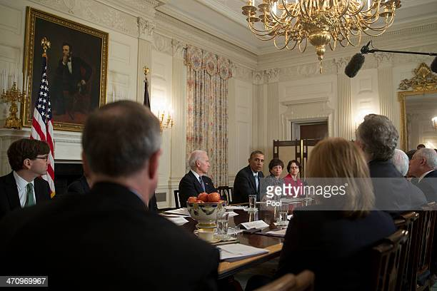 S President Barack Obama third from right speaks while meeting with members of the Democratic Governors Association in the State Dining Room with...