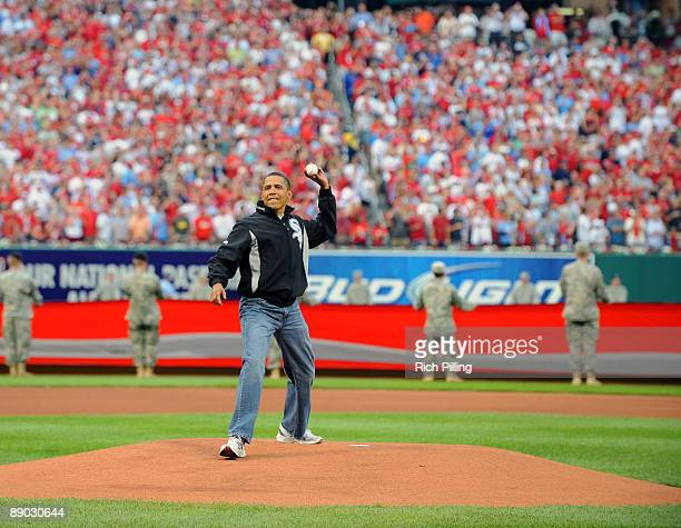 President Barack Obama throws out the first pitch before the 2009 All-Star Game at Busch Stadium July 14, 2009 in St. Louis, Missouri. The American...