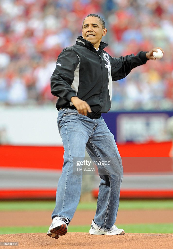 US President Barack Obama throws out the first pitch of ...