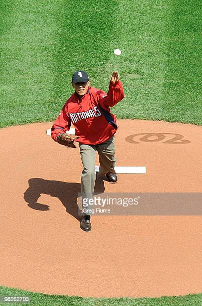 S President Barack Obama throws out the opening pitch before the game between the Philadelphia Phillies and the Washington Nationals on Opening Day...