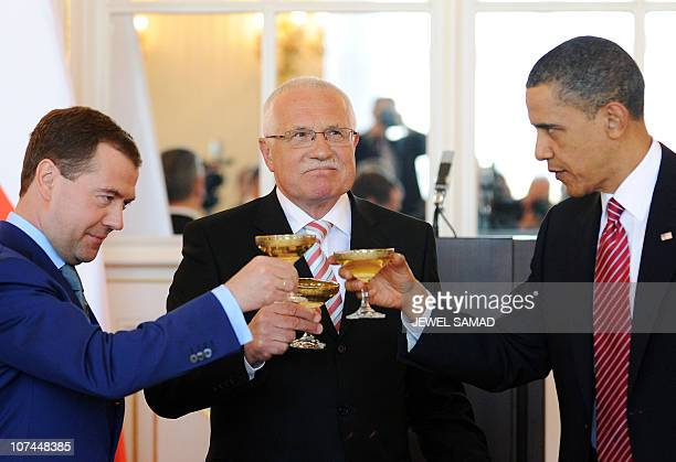 US President Barack Obama toasts with his Czech Republic's counterpart Vaclav Klaus and Russian President Dmitry Medvedev after signing the new...