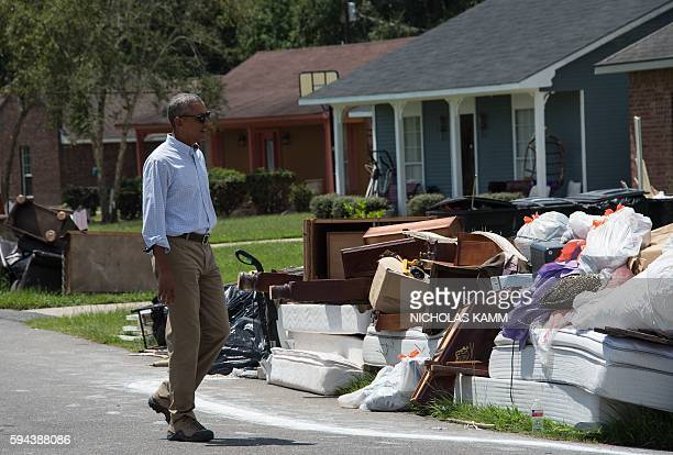 President Barack Obama tours a flood-affected area in Baton Rouge, Louisiana, on August 23, 2016. President Barack Obama touched down in...