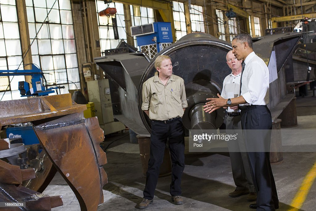 U.S. President Barack Obama (R) tours Ellicott Dredges, a manufacturing facility, on May 17, 2013 in Baltimore, Maryland. Obama's visit to Baltimore includes a visit to an elementary School, a manufacturing plant and a local community center.