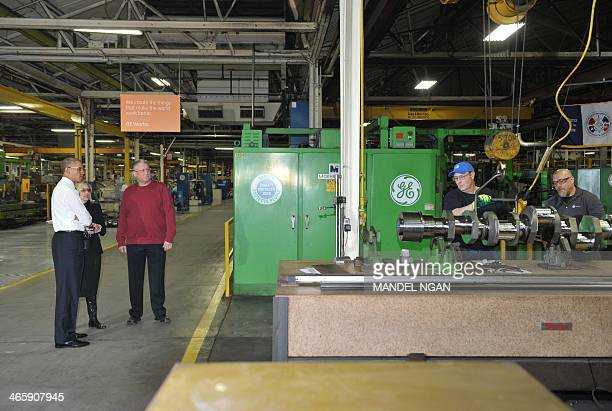 US President Barack Obama tours the General Electric Waukesha Gas Engines facility on January 30 2014 in Waukesha Wisconsin The President is expected...