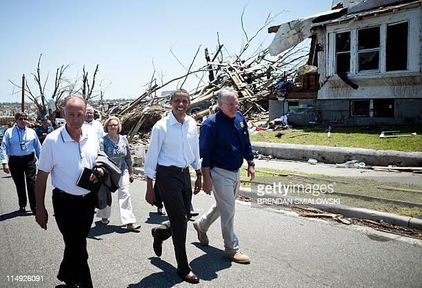 President Barack Obama tours tornado damage with Joplin Mayor Michael R. Woolston , Missouri Governor Jay Nixon and others on May 29, 2011 in Joplin,...