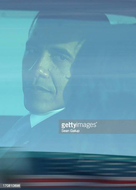 S President Barack Obama turns to his wife Michelle as they sit in their limousine after descending from Air Force One upon their arrival at Tegel...