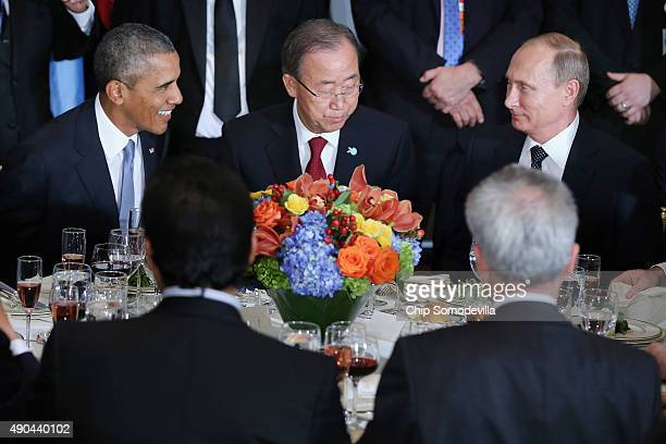 President Barack Obama, United Nations Secretary-General Ban Ki-moon and Russian President Vladimir Putin sit together during a luncheon hosted by...