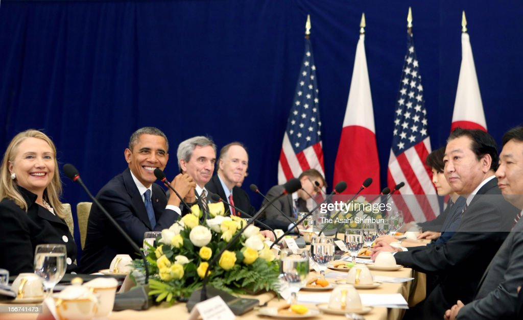 U.S. President Barack Obama (2L), U.S. Secretary of State Hillary Clinton (1L) and Japanese Prime Minister Yoshihiko Noda (2R) pose for photographs during their bilateral meeting on the sidelines of the East Asian Summit on November 20, 2012 in Phnom Penh, Cambodia.