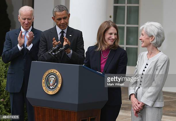 S President Barack Obama US Vice President Joe Biden and Director of the White House Office of Management and Budget Sylvia Mathews Burwell applaud...