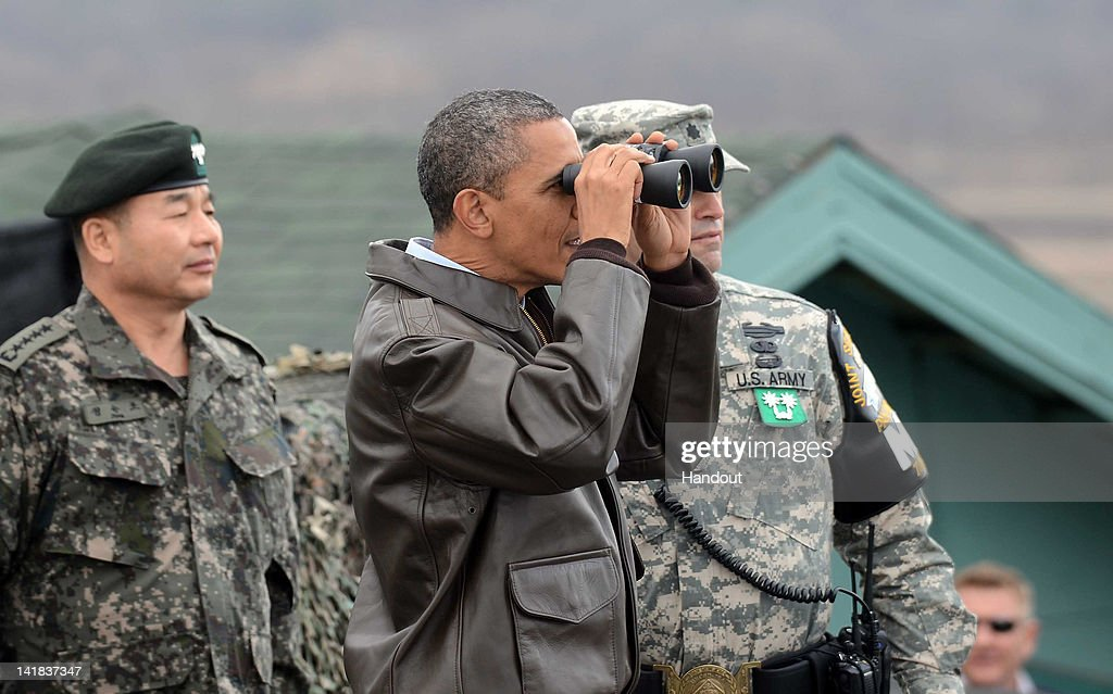 U.S. President Barack Obama uses binoculars to look at North Korea from the Observation Post Ouellette in the Demilitarized Zone which separates the two Koreas in the inter-Korean truce village of Panmunjom on March 25, 2012 in Panmunjom, South Korea. World leaders gather at Seoul to discuss on the issues to prevent possible nuclear terrorism and recurrence of meltdown of nuclear power plants and to minimize nuclear material across the world.