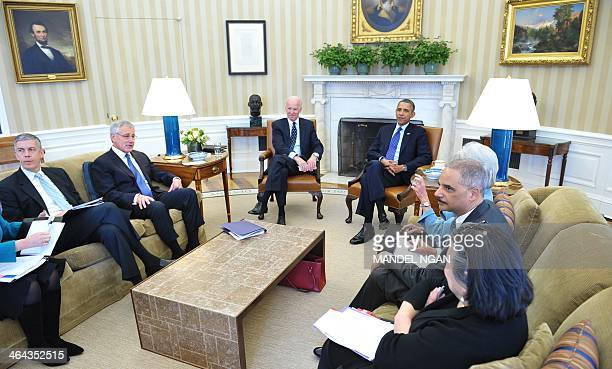 US President Barack Obama Vice President Joe Biden and cabinet secretaries meet with the Council on Women and Girls in the Oval Office of the White...