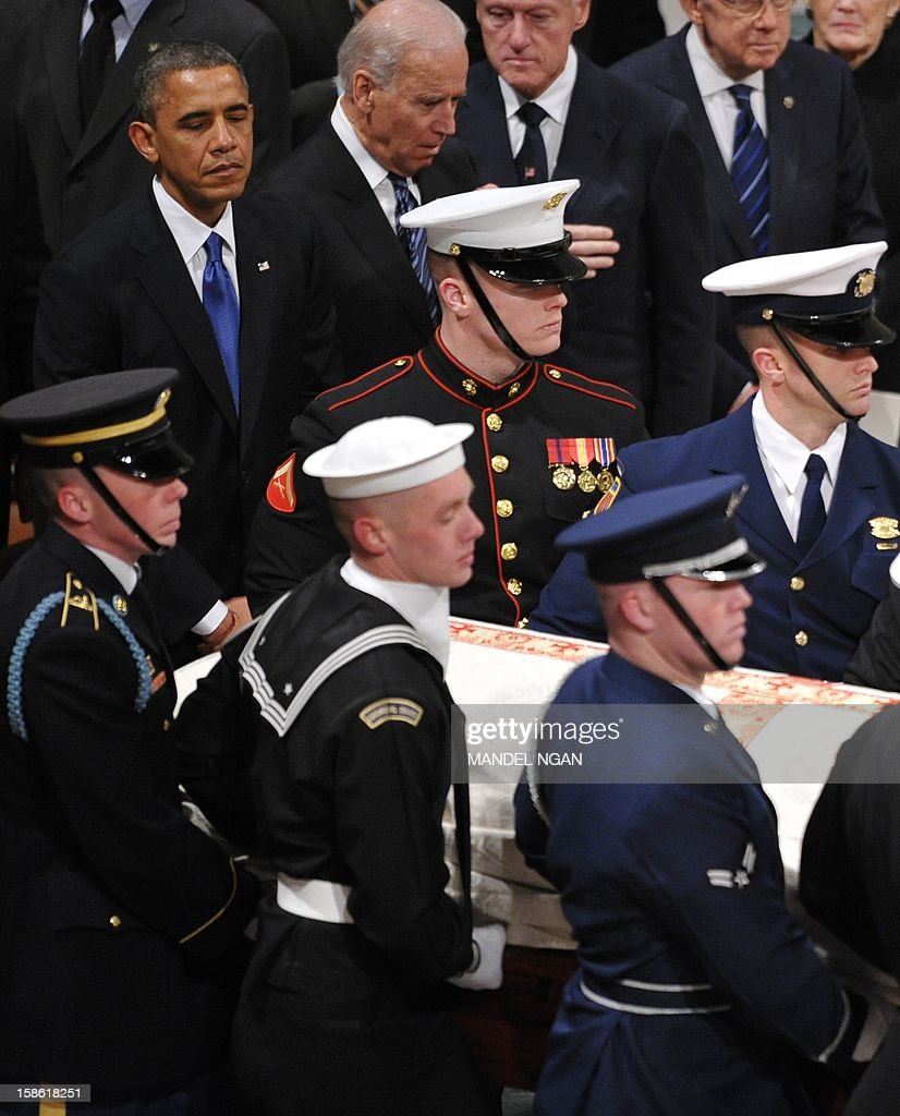 US President Barack Obama, Vice President Joe Biden and former US president Bill Clinton watch as the casket bearing Senator Daniel Inouye arrives on December 21, 2012 at the National Cathedral in Washington, DC. The Hawaii Democrat was the longest-serving senator at the time of his death Monday at age 88. AFP PHOTO/Mandel NGAN