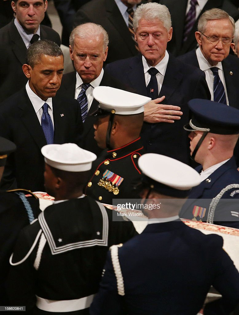 President Barack Obama, Vice President Joseph Biden, former U.S. President Bill Clinton and Senate Majority Leader Sen. Harry Reid (D-NV) watch as the casket of Sen. Daniel Inouye (D-HI) is carried past during a funeral service at the National Cathedral on December 21, 2012 in Washington, DC. Sen. Inouye, who was the most senior senator and a Medal of Honor recipient, died on December 17 at the age of 88.