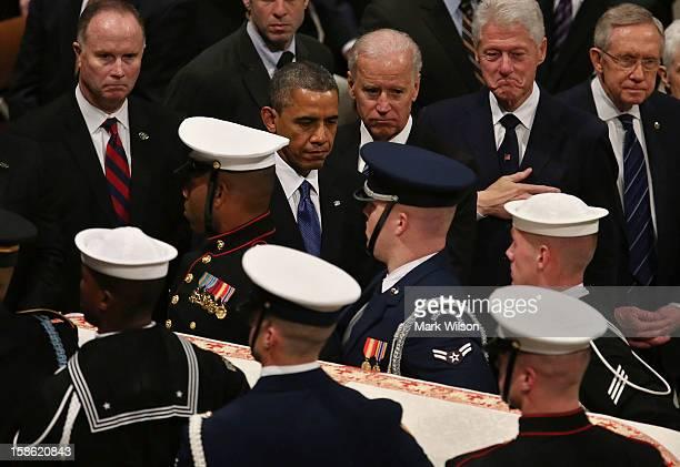 President Barack Obama Vice President Joseph Biden former US President Bill Clinton and Senate Majority Leader Sen Harry Reid watch as the casket of...