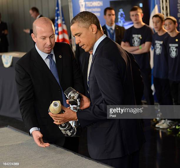 S President Barack Obama views a robotic snake used in search and rescue at an Israeli technology exhibition in the Israel Museum on March 21 2013 in...