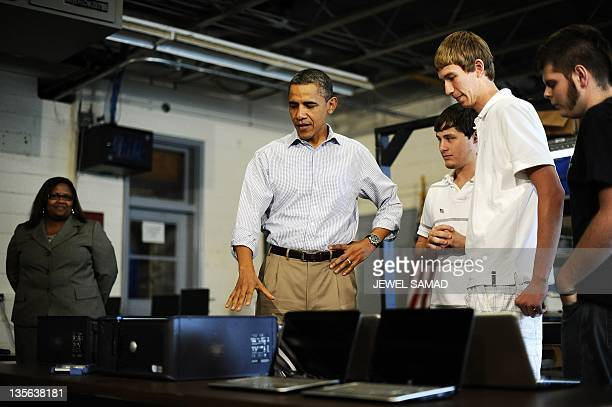 US President Barack Obama visits a classroom of the Bluestone High school in Skipwith Virginia on October 18 2011 during the second day of his...