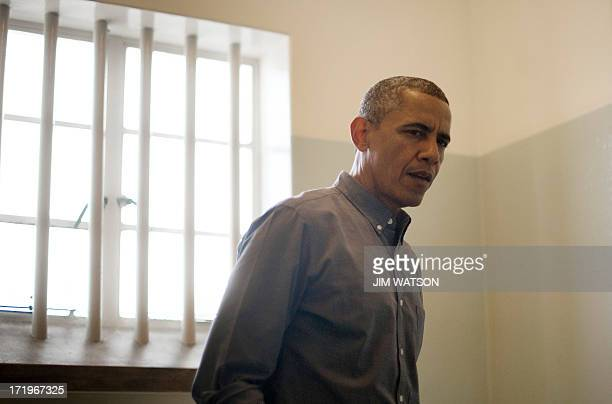 US President Barack Obama visits the cell where Nelson Mandela an antiapartheid activist was once jailed on Robben Island on June 30 2013 Paying...
