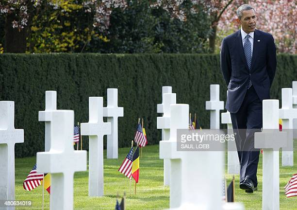 US President Barack Obama visits the WWI Flanders Field Cemetery in Waregem on March 26 2014 The cemetery is the final resting place for 368...