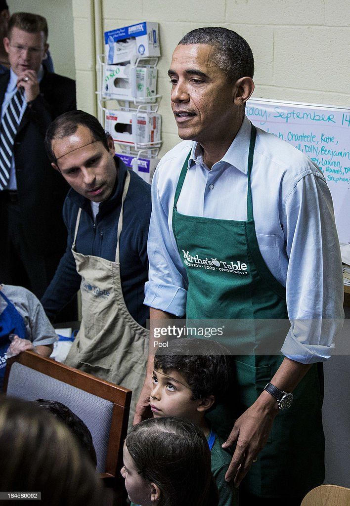 U.S. President Barack Obama visits visits with children on a day of service field trip at a Martha's Table kitchen on October 14, 2013 in Washington, D.C. During a statement, Obama called on congress to end the budget stalemate and allow federal employees to return to work.
