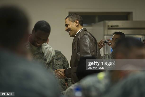President Barack Obama visits with troops in the Dragon dining facility at Bagram Air Base on March 28, 2010. Obama thanked the Afghan people and US...