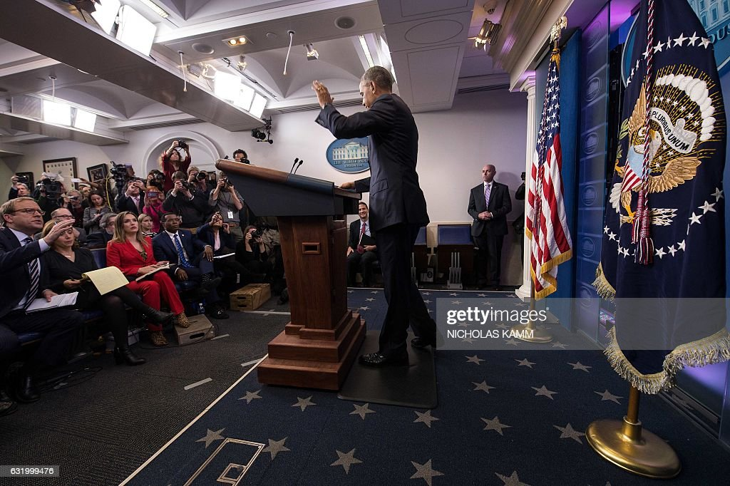 US President Barack Obama waits at the end of his final press conference at the White House in Washington, DC, on January 18, 2017. US President Barack Obama said Wednesday he would take a break from politics upon leaving office, but would not hesitate to speak up if America's 'core values' are questioned, citing concerns about discrimination and freedom of the press. KAMM