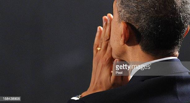 S President Barack Obama waits to speak at an interfaith vigil for the shooting victims from Sandy Hook Elementary School on December 16 2012 at...