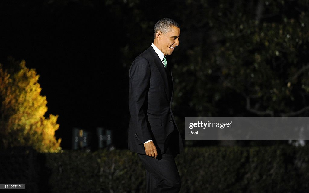 U.S. President Barack Obama walks across the South Lawn before boarding Marine One to depart the White House on March 19, 2013 in Washington, DC. Obama will travel to Tel Aviv, Israel to attend bilaterals.