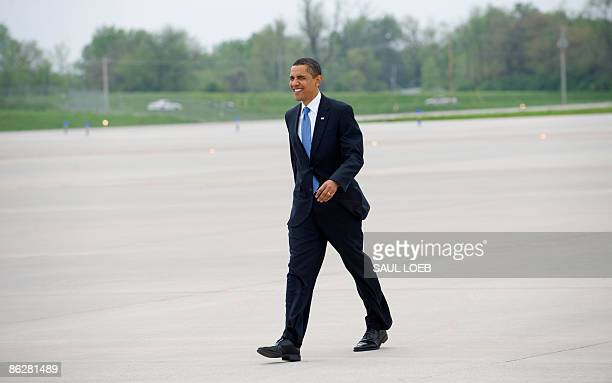 US President Barack Obama walks across the tarmac to greet trooops before departing on Air Force One from LambertSt Louis International Airport in St...