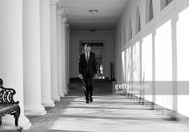 President Barack Obama walks along the colonnade at the White House in Washington DC on January 24 2012 Obama will set out to convince Americans he...