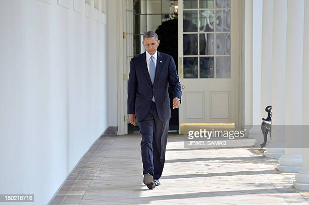 US President Barack Obama walks along the colonnade at the White House to the Oval Office on September 10 2013 in Washington DC President Obama has...