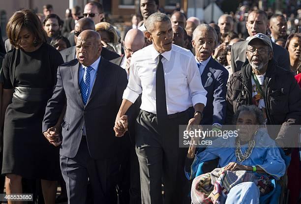 President Barack Obama walks alongside Amelia Boynton Robinson , one of the original marchers, First Lady Michelle Obama , and US Representative John...