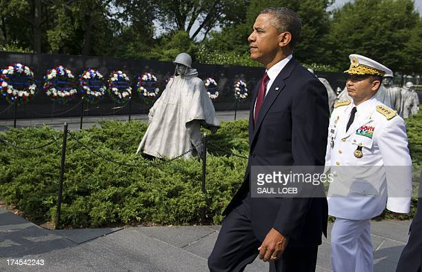 US President Barack Obama walks alongside Korean General Jung Seungjo Chairman of Korea's Joint Chiefs of Staff prior to laying a wreath at the...