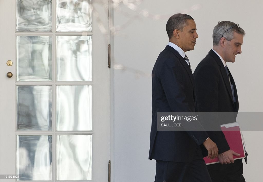 US President Barack Obama walks alongside White House Chief of Staff Denis McDonough (R) down the West Wing Colonnade at the White House in Washington, DC, February 12, 2013