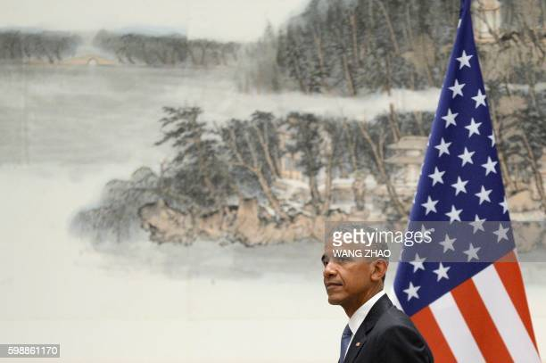 US President Barack Obama walks as he meets with Chinese President Xi Jinping at the West Lake State Guest House in Hangzhou on September 3 ahead of...