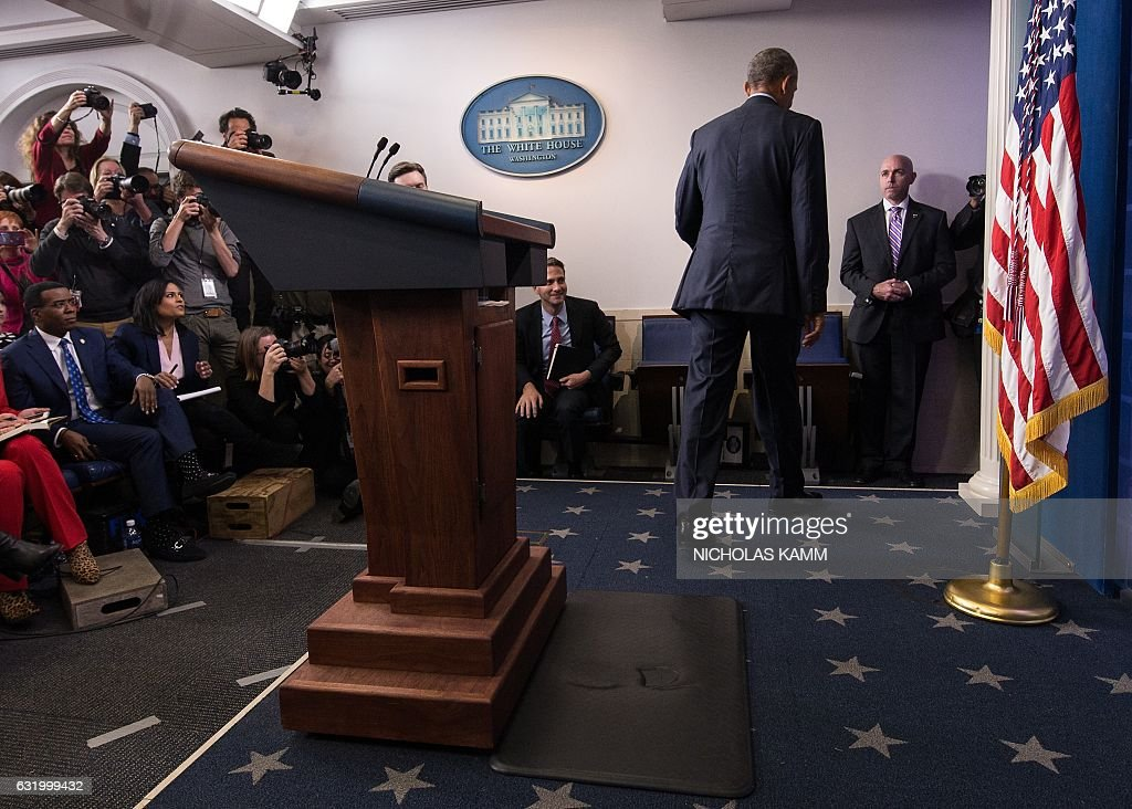 US President Barack Obama walks away at the end of his final press conference at the White House in Washington, DC, on January 18, 2017. US President Barack Obama said Wednesday he would take a break from politics upon leaving office, but would not hesitate to speak up if America's 'core values' are questioned, citing concerns about discrimination and freedom of the press. KAMM