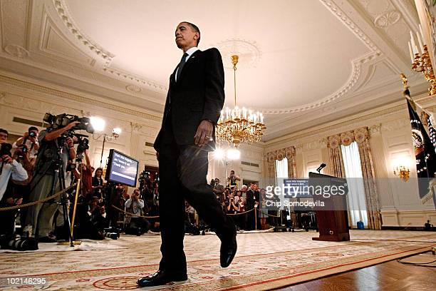 President Barack Obama walks away from the podium after addressing the press in the State Dining Room following a meeting with executive from BP at...