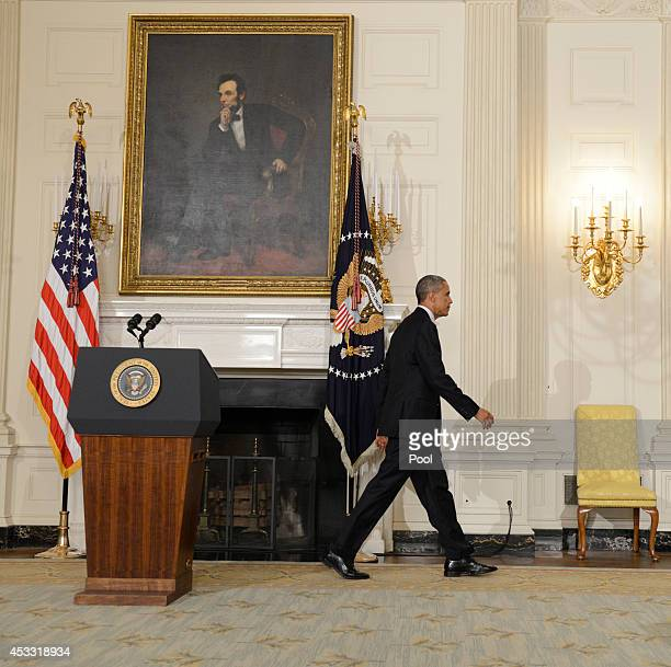 US President Barack Obama walks away from the podium after addressing the nation in the State Dining Room of the White House on August 7 2014 in...