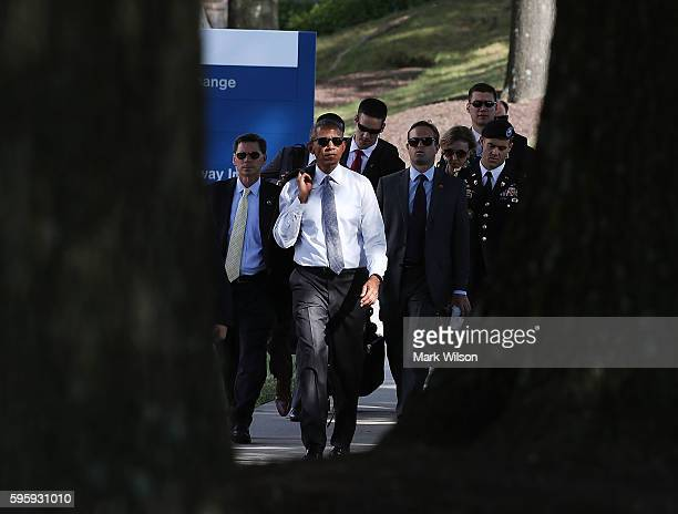 US President Barack Obama walks away from Walter Reed National Medical Center August 26 2016 in Bethesda Marland President Obama visited with wounded...