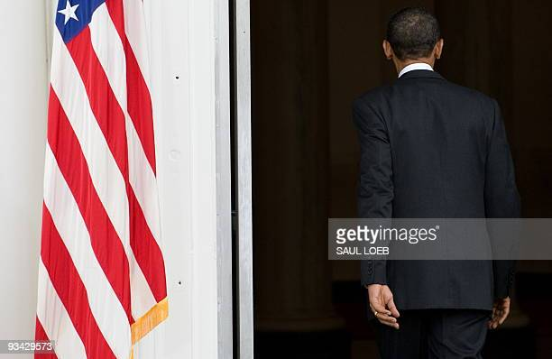 US President Barack Obama walks back into the White House after pardoning a turkey named Courage during the annual turkey pardoning ceremony for...