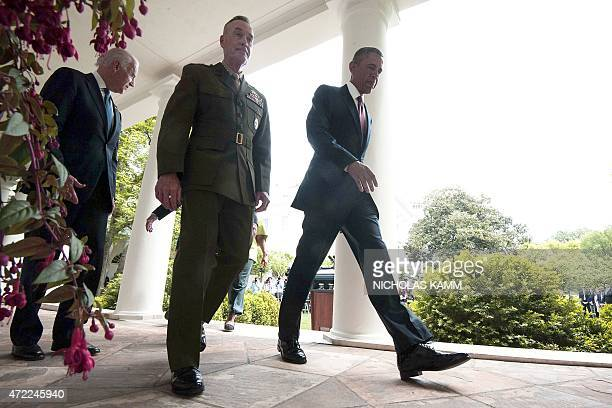 US President Barack Obama walks back to the Oval Office after announcing Marine Gen Joseph Dunford as his pick to be the next chairman of the Joint...